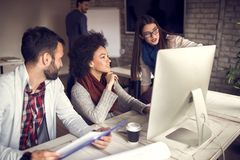 Young people working together in designer's office royalty free stock photo
