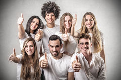 Young people wth their thumb up. Happy young people with their thumb up Royalty Free Stock Photo