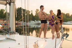 Young people on the yacht. Stock Photography