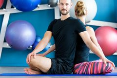 Young people in yoga class. Yoga group stock photo