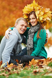 Young peoples at autumn outdoors Royalty Free Stock Image