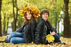 Young peoples at autumn outdoors Royalty Free Stock Photos