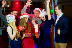 Young peoples Christmas party. In the nightclub. Dancing on the dancefloor Royalty Free Stock Photography