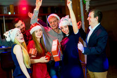 Young peoples Christmas party. In the nightclub. Dancing on the dancefloor Stock Photo