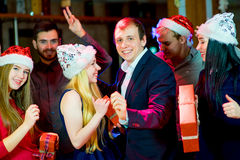 Young peoples Christmas party. In the nightclub. Dancing on the dancefloor Stock Photography