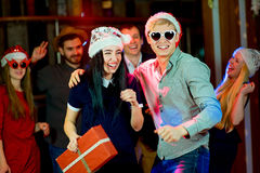 Young peoples Christmas party. In the nightclub. Dancing on the dancefloor royalty free stock photos