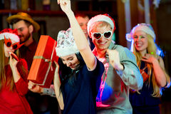 Young peoples Christmas party. In the nightclub. Dancing on the dancefloor Royalty Free Stock Images