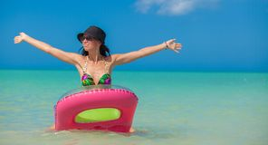Young perfect woman on an air mattress in the sea Royalty Free Stock Image