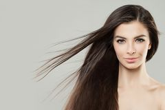 Young Perfect Woman with Blowing Hair. Beauty Female Face Stock Image