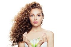 Young Perfect Woman With Long Curly Hairstyle, Healthy Skin And Lily Flower In Her Hands Isolated On White Background Royalty Free Stock Image