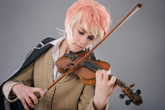 Young performer woman playing the violin. Royalty Free Stock Images
