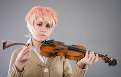 Young performer woman playing the violin. Royalty Free Stock Photo