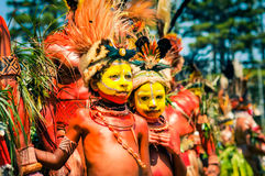 Young performers in Papua New Guinea. Hagen show, Papua New Guinea - circa August 2015: Half-naked boys with yellow colour on faces and red colour on bodies Royalty Free Stock Photos