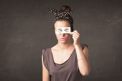 Young person holding paper with angry eye drawing. Concept Stock Images