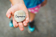 Young person holding stone with inscription Stock Image