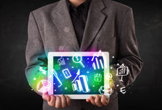 Young person holding tablet with graph and chart symbols Stock Images
