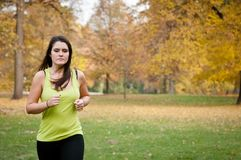 Young person jogging outdoor in nature Stock Images