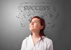 Young person looking forward to a new idea. Young pretty person looking forward to success stock images