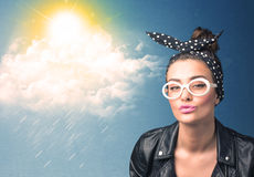 Young person looking with sunglasses at clouds and sun Stock Image
