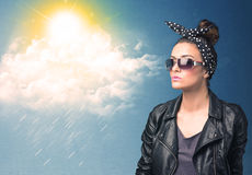 Young person looking with sunglasses at clouds and sun Stock Photography
