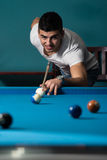 Young Person Playing Snooker. Young Man Lining To Hit Ball On Pool Table Stock Images