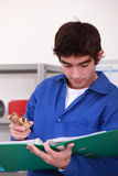 Young  person with plumbing Stock Image