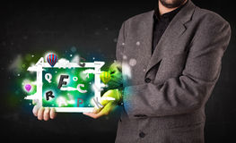 Young person showing tablet with abstract letters and sky Royalty Free Stock Photos