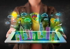 Young person showing tablet with hand drawn cityscape Stock Photo