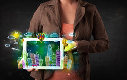 Young person showing tablet with hand drawn cityscape Royalty Free Stock Photo