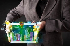 Young person showing tablet with hand drawn cityscape Royalty Free Stock Image