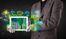 Young person showing tablet with hand drawn cityscape Stock Photography