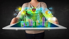Young person showing tablet with hand drawn cityscape Stock Image