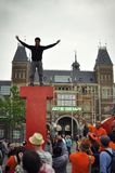 Young person standing on top of the Iamsterdam sign. April 2015, Museumplein, Amsterdam. A young man standing on the top of the I letter of the Iamsterdam sign Royalty Free Stock Photography