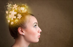 Young person thinking with glowing puzzle mind. On grungy background Stock Image