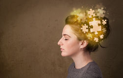 Young person thinking with glowing puzzle mind stock illustration