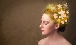 Young person thinking with glowing puzzle mind Stock Photography