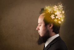 Young person thinking with glowing puzzle mind Stock Images