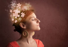 Young person thinking with glowing puzzle mind. On grungy background Royalty Free Stock Photos