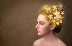 Young person thinking with glowing puzzle mind Stock Image