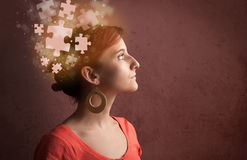Young person thinking with glowing puzzle mind. On grungy background Royalty Free Stock Photo