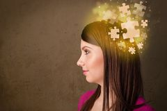 Young person thinking with glowing puzzle mind. On grungy background Royalty Free Stock Image