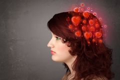 Young person thinking about love with red hearts Royalty Free Stock Image