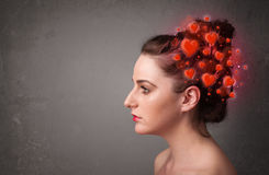 Young person thinking about love with red hearts Royalty Free Stock Images