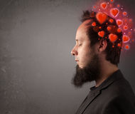 Young person thinking about love with red hearts Stock Photography