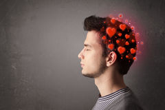 Young person thinking about love with red hearts Stock Image