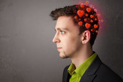Young person thinking about love with red hearts Stock Images