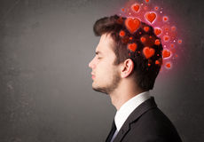 Young person thinking about love with red hearts Royalty Free Stock Photos