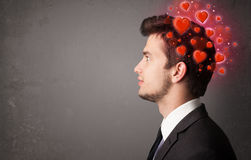 Young person thinking about love with red hearts Stock Photo