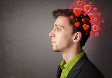 Young person thinking about love with red hearts Royalty Free Stock Photography