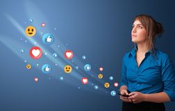 Young person using phone with social media concept royalty free stock images